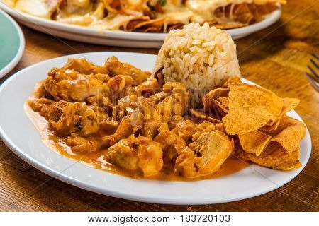 Chicken chipotle Mexican dish served with tortilla chips
