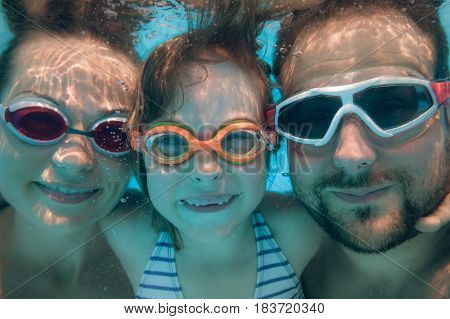 Underwater Portrait Of Family