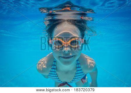 Underwater Portrait Of Child