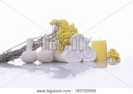 Spa treatment with blooming branch yellow flower,on white background