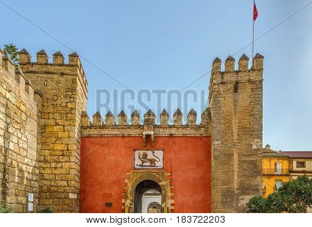 Lion's Gate is entrance to Alcazar of Seville Spain