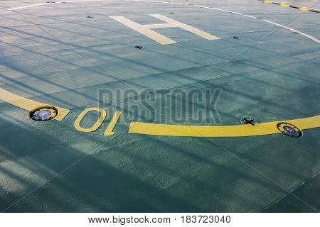 Helipad sign on a ship deck with spotlight and diameter figure