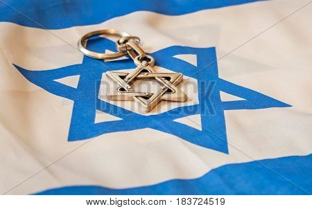 Star of David, Jewish religion symbol on Israel flag stock image. Jewish identity, Bar mitzvah, Israel Independence Day, Zionism vs. Judaism, Jewish vs. Democratic. Jewish hexagram. Abstract kosher image.