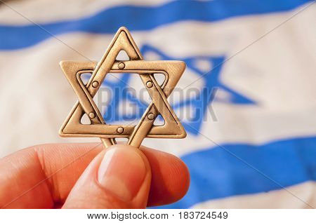 Hand holding a Star of David (