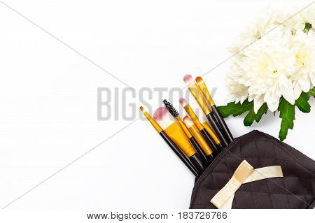 Make-up Brushes And A Chrysanthemum Flower On A White Background.