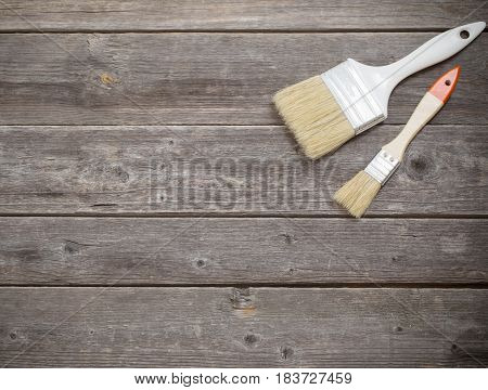 the brush on a dark wooden background