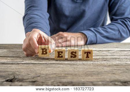 Man Assembling Word Best