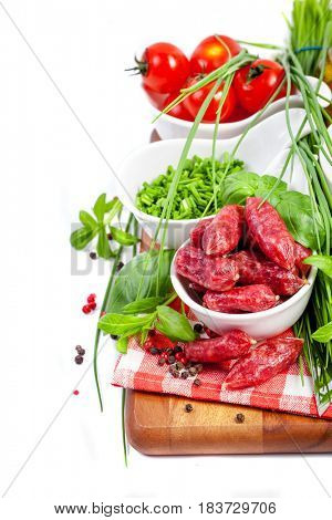 Assorted meats and sausages on a wooden board