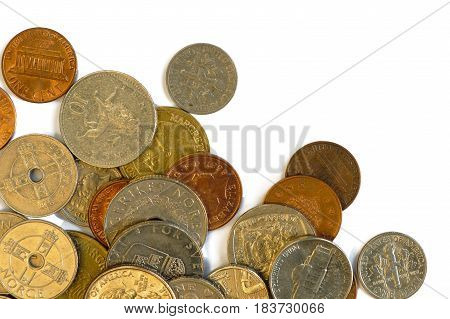 Coins of multiple countries isolated on white. Flat lay top view