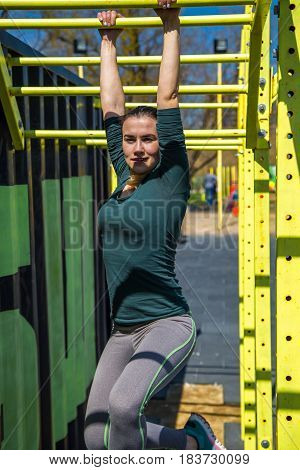 Woman In Sports Clothes On The Playground