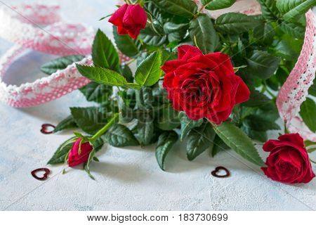 Background Wedding, Mother's Day Or Birthday. A Bouquet Of Fresh Red Rose Flowers On A Blue Backgrou