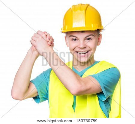 Emotional portrait of teen boy wearing safety jacket and hard hat. Happy child looking at camera, isolated on white background. Funny cute engineer, entrepreneur, construction worker or architect.