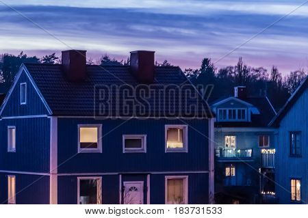 Blue wooden house in Gothenburg Sweden at sunset
