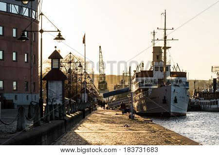 Romantic harbor port scene in Gothenburg at sunset