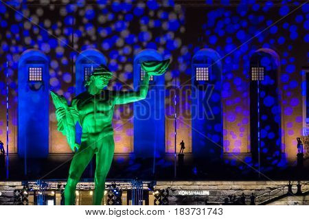 Bronze Statue of Poseidon in Sweden with colorful light show
