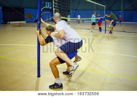MOSCOW - SEP 13, 20616: Alexey Serikov trains volleyball team in gym of Moscow University of Technology