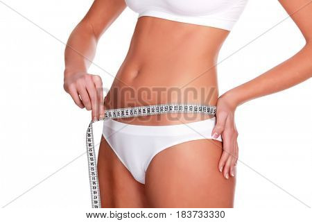 Woman measures her waist, isolated on white background