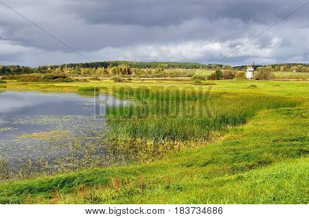 Autumn picturesque landscape -autumn view of Malenets lake and valley in Pushkinskiye Gory Russia - autumn natural landscape of autumn nature in sunny autumn weather. Autumn colorful landscape