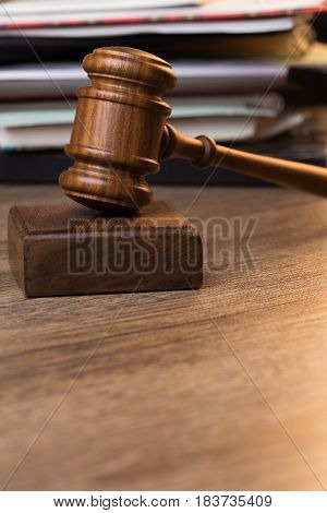 Image of hammer against documents