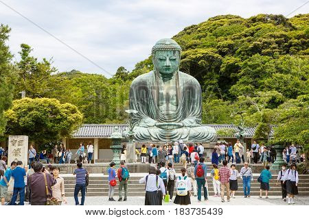 KAMAKURA, JAPAN - MAY 24, 2015: The Great Buddha of Kamakura in Kotokuin Temple, Kanagawa, Japan. With a height of 13 meters, it is the second largest bronze Buddha statue in Japan.