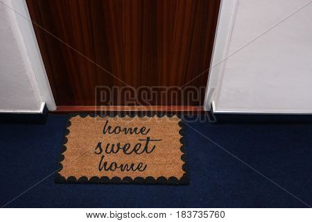 A welcome mat depicting the words Home Sweet Home