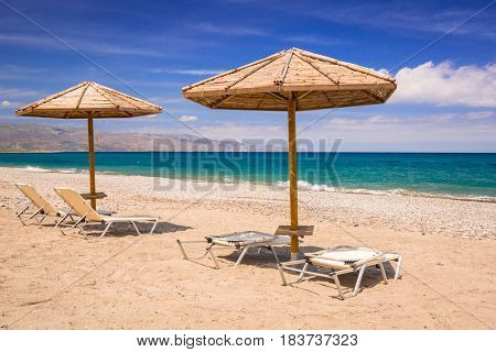 Tropical parasols at Maleme beach on Crete, Greece