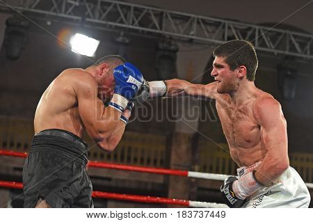 Kyiv Ukraine - December 24 2016: An unidentified boxers in the ring during fight for ranking points in the NSC Olimpiyskiy Kyiv Ukraine