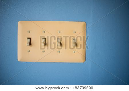 Light Switch for off and on with blue wall background