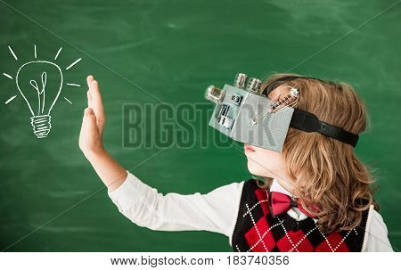 Schoolchild With Virtual Reality Headset In Class
