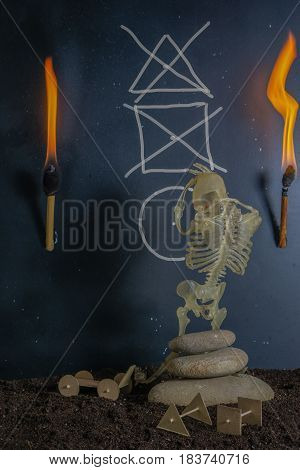 invention of the wheel. skeleton sitting at the ancient cave in torch light. image show creativity process. concept image