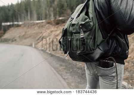 The man in the woods. Male with a black backpack