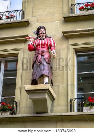 BERN, SWITZERLAND - JUNE 5, 2016:  Butcher statue at Guildhouse building Kramgasse street in Bern. Canton of Bern. Switzerland