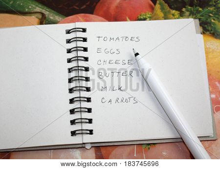 Grocery shopping list checklist note and pencil