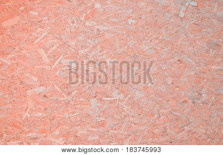 Light pastel pink plywood chipboard background texture
