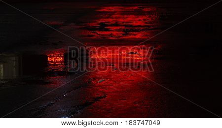 wet road asphalt reflections red light red