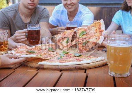 People eating pizza in cafe