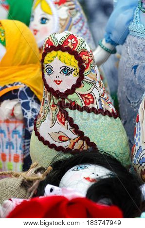 Trade in the market, the traditional doll amulet in the form of dolls made from scraps of fabric. Selective focus.