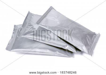 Sealed Aluminum Sachets Lying on White Background