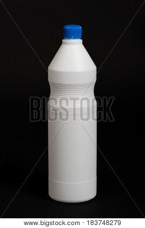 White plastic bottle on black background