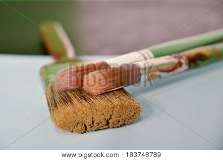 A worms eye view of three paintbrushes