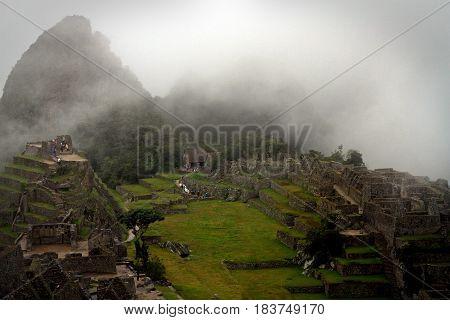 Lost peruvian city MAchu Picchu in fog 2