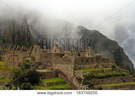 Lost peruvian city Machu Picchu in fog