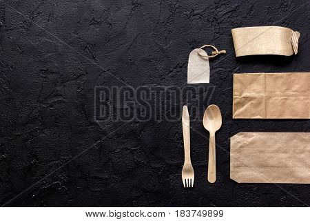 food delivery service workdesk with paper bags and flatware on restourant dark table background top view mockup