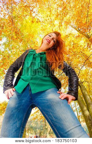 Leisure relax nature joy loud voice concept. Girl having fun in forest. Cheerful lady yelling screaming in autumnal woodland. Wide angle view