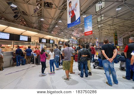COLOGNE, GERMANY - CIRCA SEPTEMBER, 2014: people check-in at Cologne Bonn Airport.