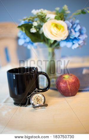 Tea Time with Mug and Pocket Watch on Table