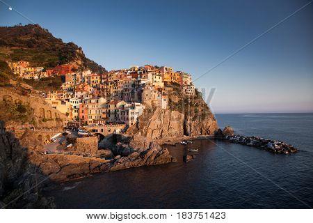 travel amazing Italy series - village of Manarola, Liguaria on the Cinque Terre coast at sunset