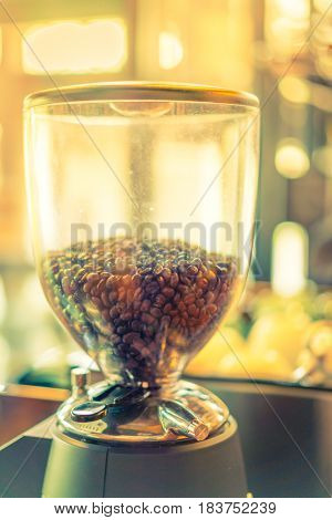 Coffee beans in machine ( Filtered image processed vintage effect. )