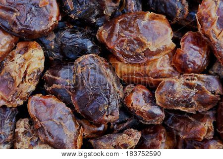Medjool dates a healthy ingredient used to sweeten recipes for example in smoothies or eaten as a snack. Can be used as a background with space for text.