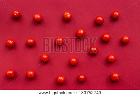 romantic dinner in red color with cherry tomatoes top view pattern